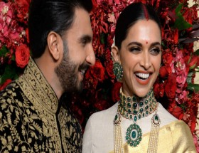 Deepika and Ranveer singh smiling bollywood couple photo
