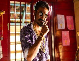 Don Dhanush Muchh with gold chain and goggles photo