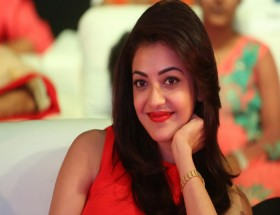 Kajal Aggarwal red lips and red dress looking pretty