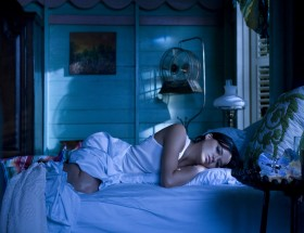 Michelle Rodriguez sleeping on bed image