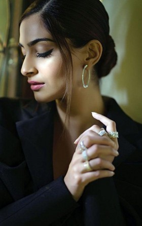 Bollywood woman Sonam Kapoor in black suit photo